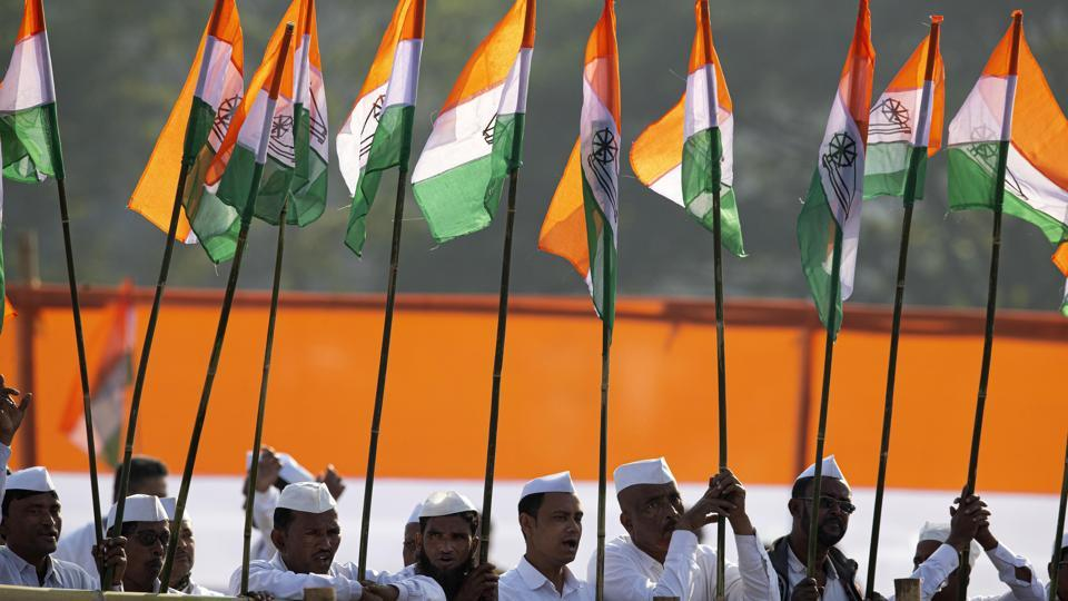 Congress party workers hold party flags as party leader Rahul Gandhi speaks at a rally against the Citizenship Amendment Act in Guwahati, India.