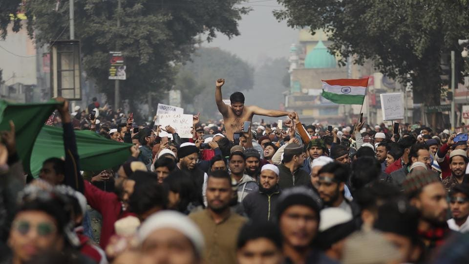 Indians march through a street during a protest against the Citizenship Amendment Act after Friday prayers in New Delhi.