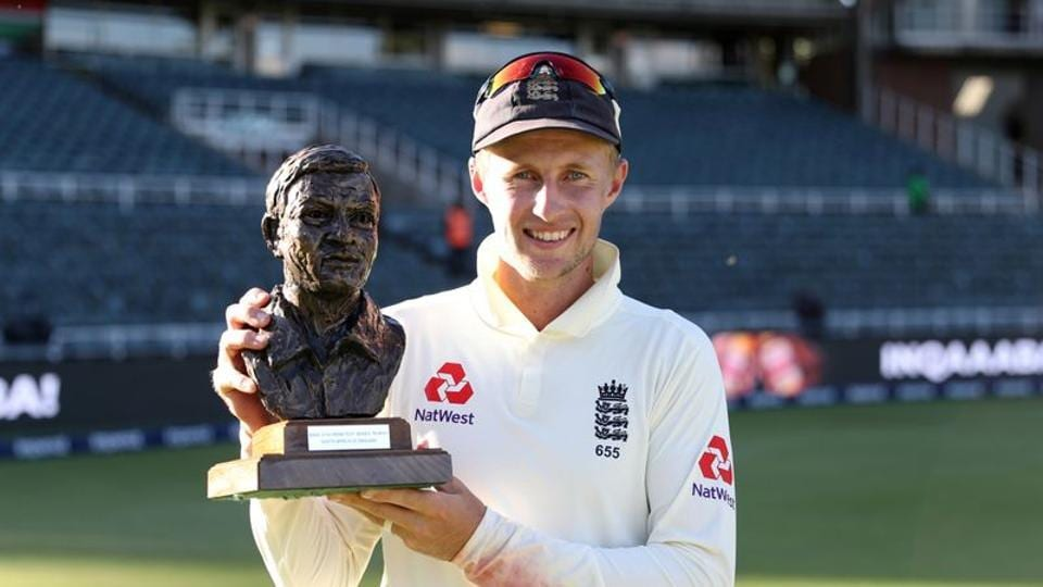 England's Joe Root poses for a photograph as he celebrates with the Basil D'Oliveira trophy