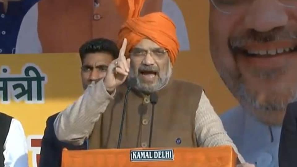 Home Minister Amit Shah addressing a poll rally in Najafgarh in Delhi on Jan 29, 2020. (Photo @BJP4India)