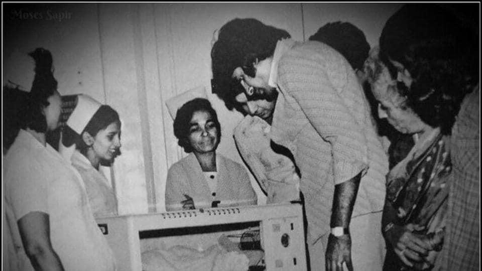 Amitabh Bachchan gazes at newborn Abhishek Bachchan.