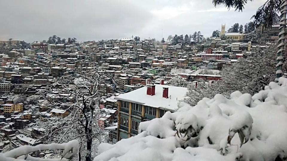 A picturesque view of Shimla town after fresh snowfall on Wednesday.