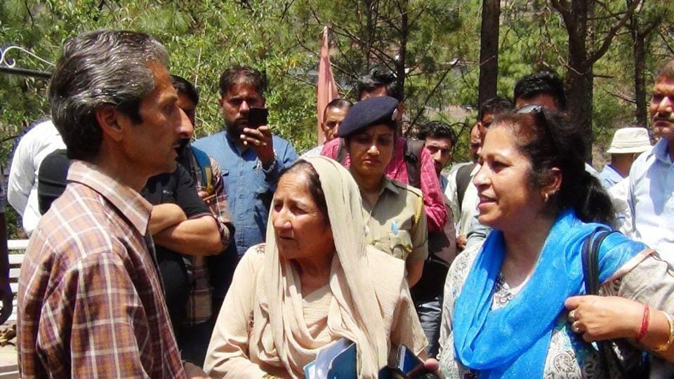 Hotel owner owner Vijay Singh (left), who is now absconding, and assistant town planner Shail Bala Sharma (right) during the demolition drive in Kasauli on May 3, 2018. Singh allegedly shot her dead minutes later.