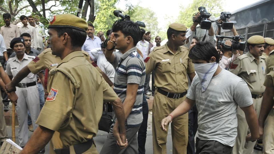 Delhi Police personals produced 16 December bus gang rape accused Akshay Thakur, Pawan Gupta, at Delhi High Court in New Delhi.