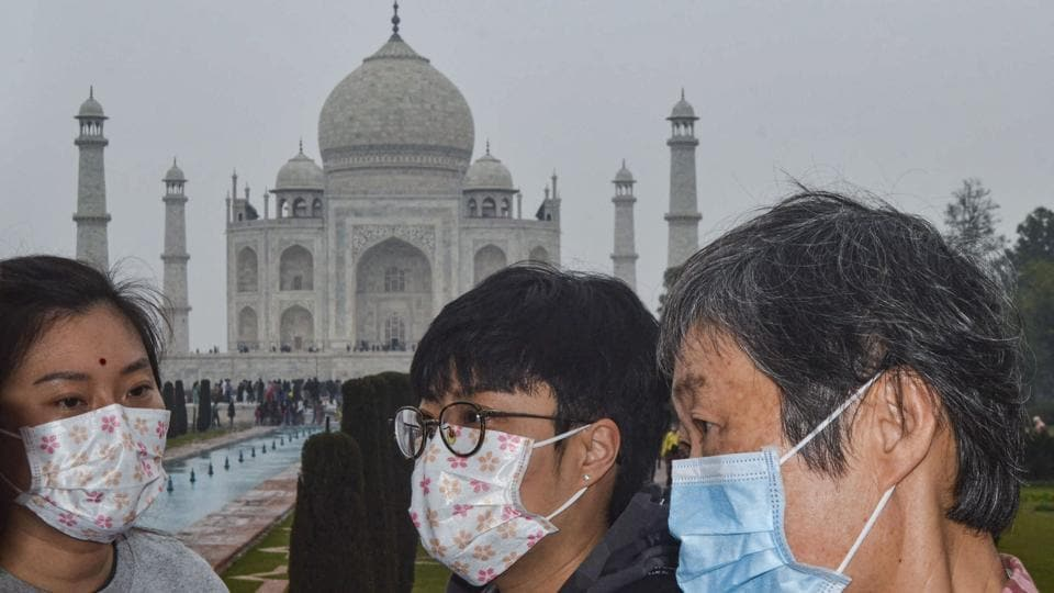Agra: Tourists, wearing protective face masks, visit Taj Mahal, in Agra, Tuesday, Jan. 28, 2020. The Centre on Monday decided to take steps for possible evacuation of over 250 Indians from the Chinese city of Wuhan, the epicentre of the coronavirus outbreak, and announced a raft of precautionary measures to deal with suspected cases.