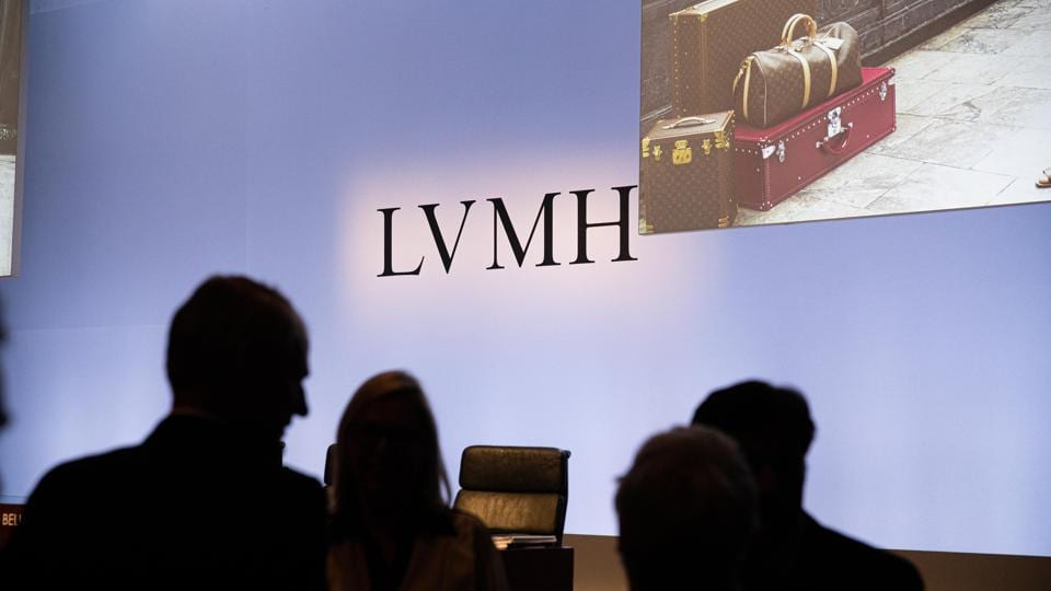 Attendees arrive to an event as LVMH Moet Hennessy Louis Vuitton announces full year earnings in Paris.