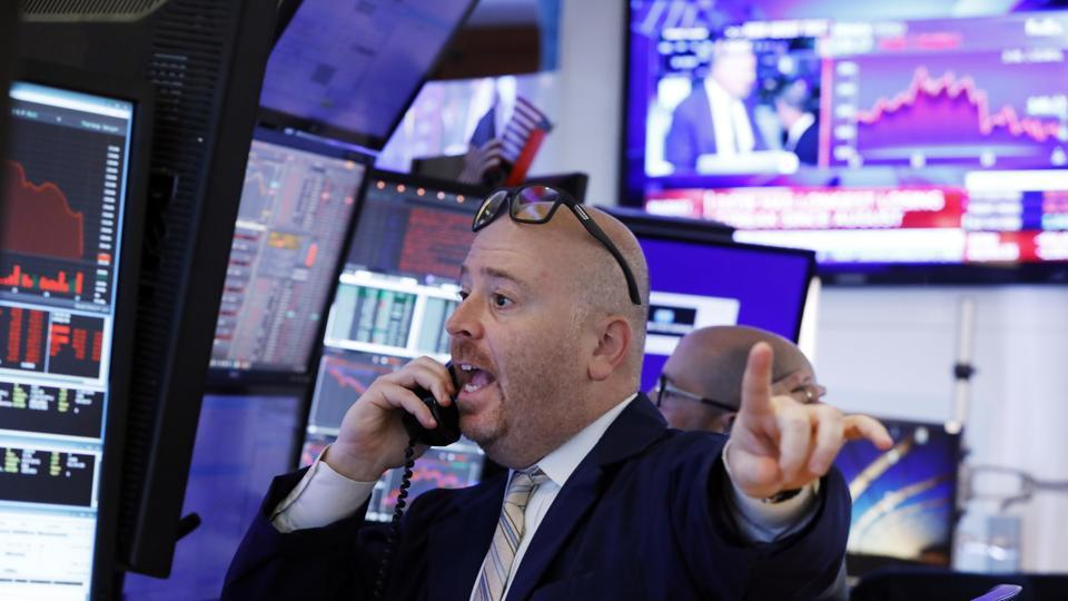 Trader Gaspare Urso works on the floor of the New York Stock Exchange.