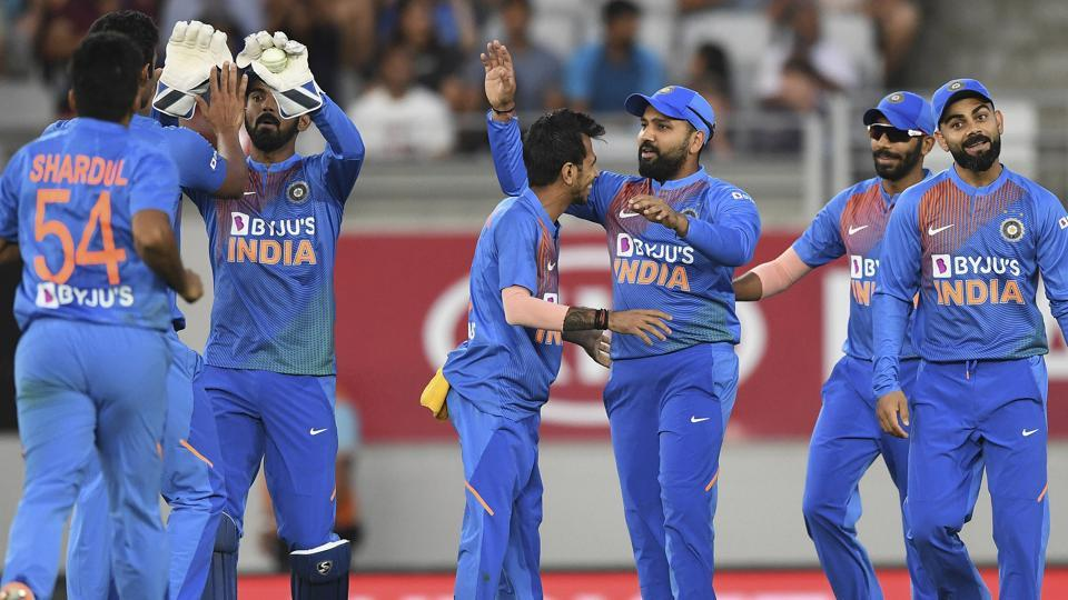 Rohit Sharma celebrates with teammates after taking a catch to dismiss New Zealand's Martin Guptill.