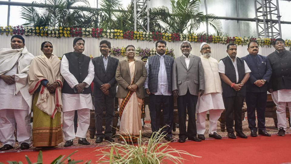 Jharkhand Governor Droupadi Murmu (5L) and Chief Minister Hemant Soren (4L) along with the newly sworn-in cabinet ministers after an oath-taking ceremony at Raj Bhawan, in Ranchi, Tuesday, Jan. 28, 2020.