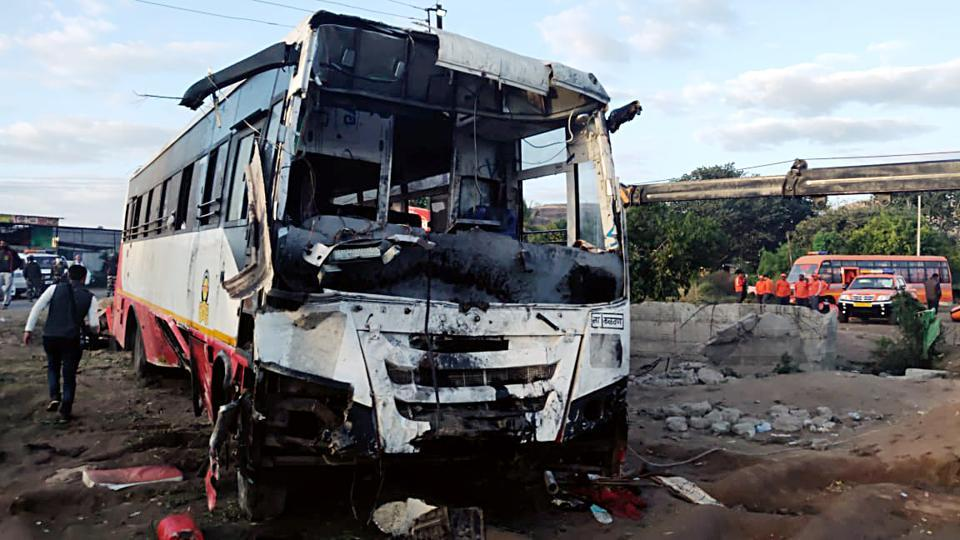 Mangled remains of a bus which collided into an auto rickshaw , resulting in the death of 26 people, in Maharashtra's  Nashik district.