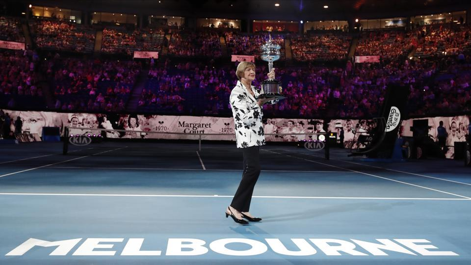 Margaret Court holds up the women's Australian Open trophy.