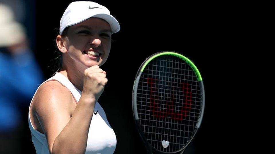 Romania's Simona Halep celebrates winning her match against Estonia's Anett Kontaveit.