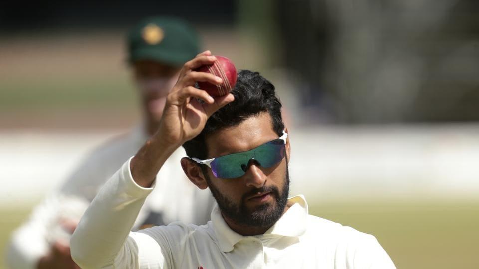 Zimbabwean player Sikandar Raza celebrates taking 7 wickets.