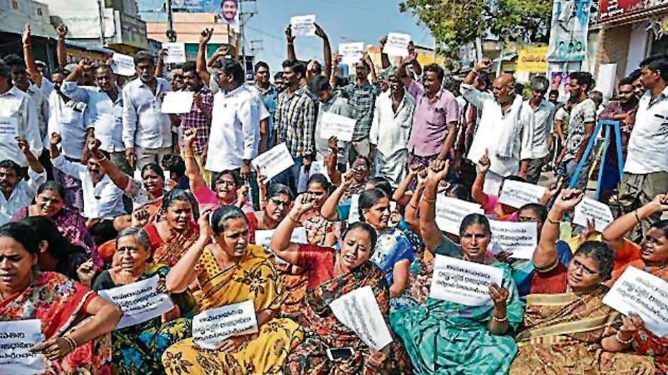 Villagers from Mandadam block a road during a protest against the statement of chief minister YS Jagan Mohan Reddy proposing three capitals for the state, in Guntur district.