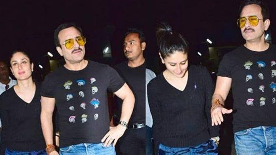Kareena and Saif were twinning in matching dark blue pants and black tops.  Check it out!