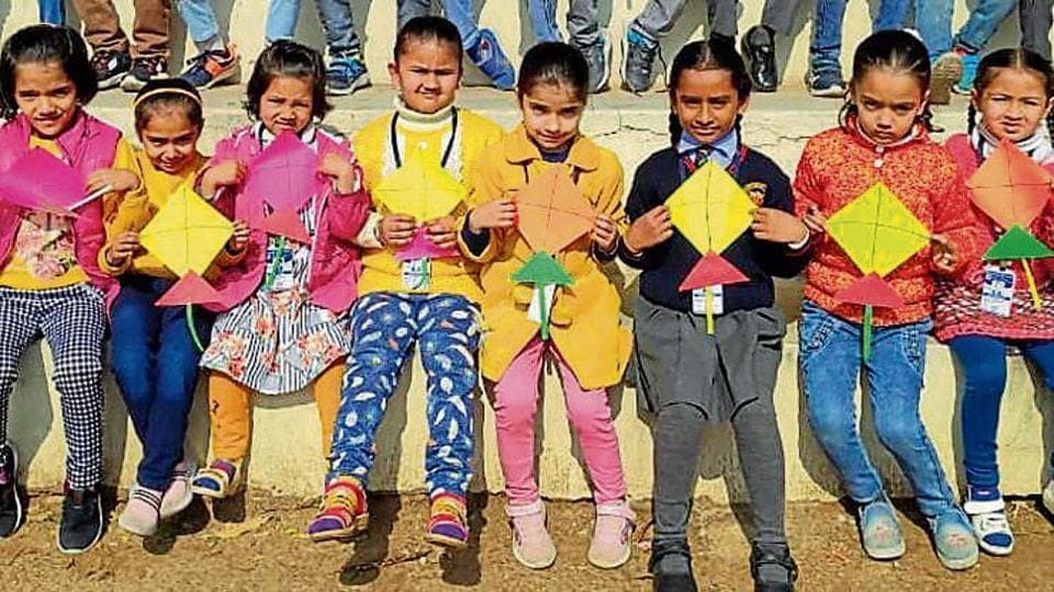 Students of DC Model Senior Secondary School with their kites.