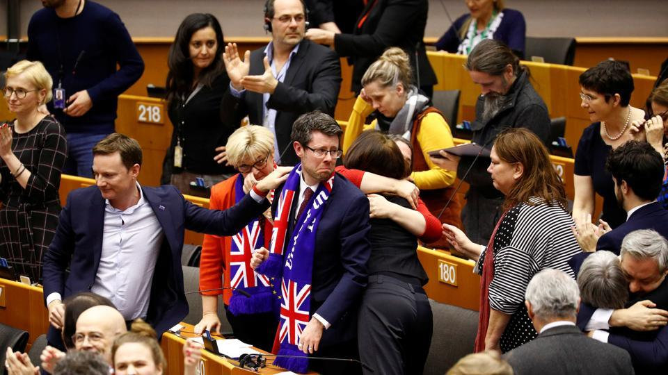 Britain's EU Parliament members react after a vote on the Withdrawal Agreement at the European Parliament in Brussels, Belgium