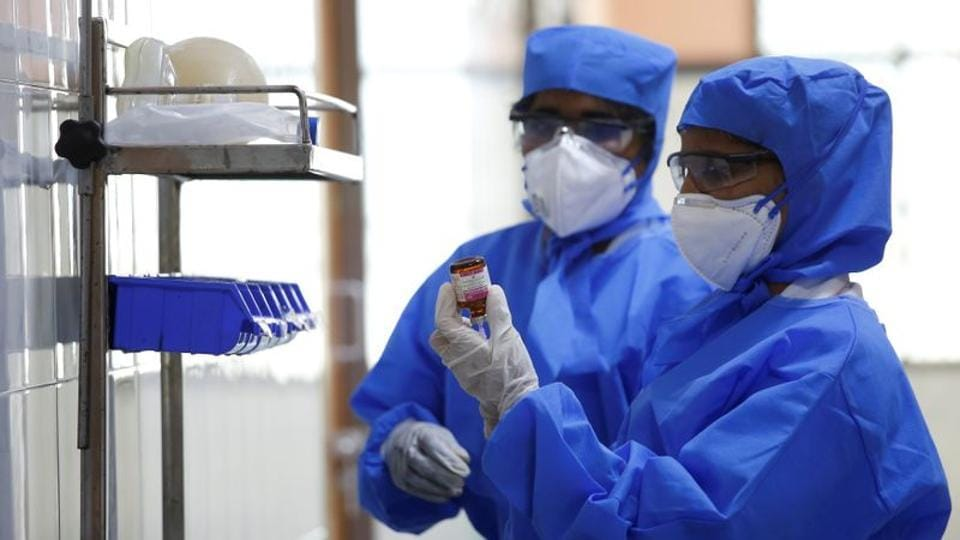 Medical staff with protective clothing are seen inside a ward specialised in receiving any person who may have been infected with coronavirus, at the Rajiv Ghandhi Government General hospital in Chennai.