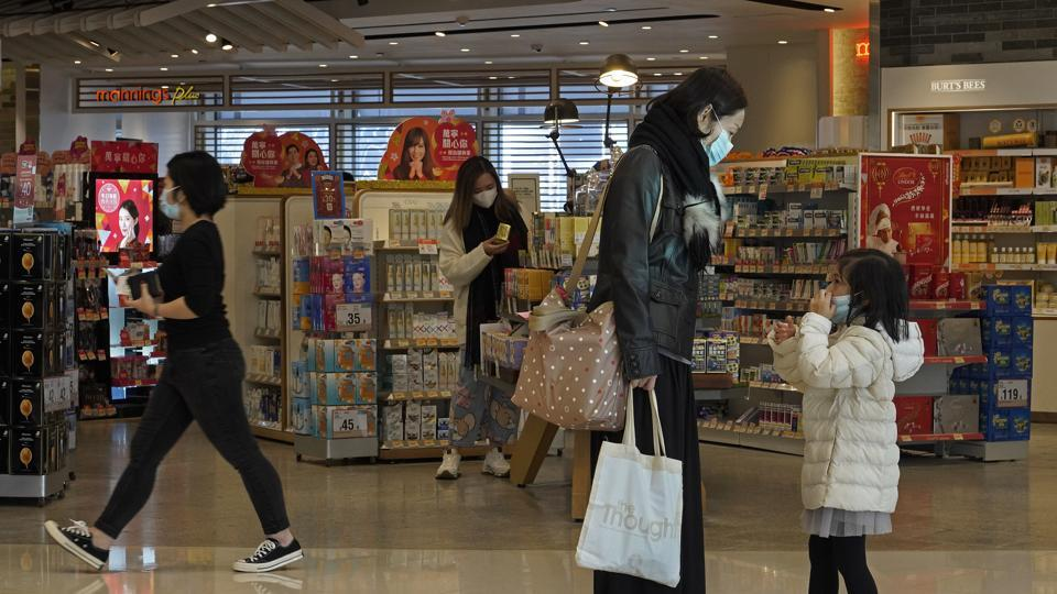 People wear face mask at a shopping mall in Hong Kong on Thursday. The death toll rose to 170 in the new virus outbreak in China on Thursday.