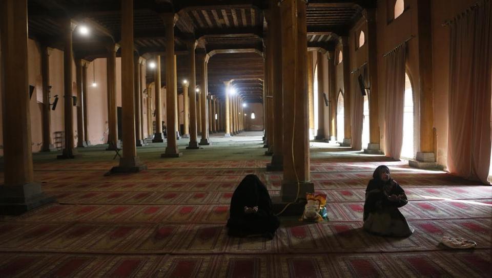 Kashmiri Muslim women pray inside Jamia Masjid in Srinagar.