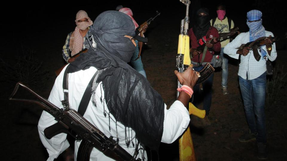 People's Liberation Front of India (PLFI) head Dinesh Gope ( back to camera) platoon showing their latest firearms in the forest at undisclosed location near Jharkhand -Odisha border. His wives were arrested by NIAon Thursday.