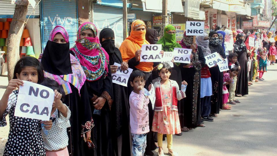 Muslim women activists form a human chain as they protest during Bharat Bandh called by Bahujan Kranti Morcha against CAA and NRC, in Bhopal on Wednesday. (ANI Photo)