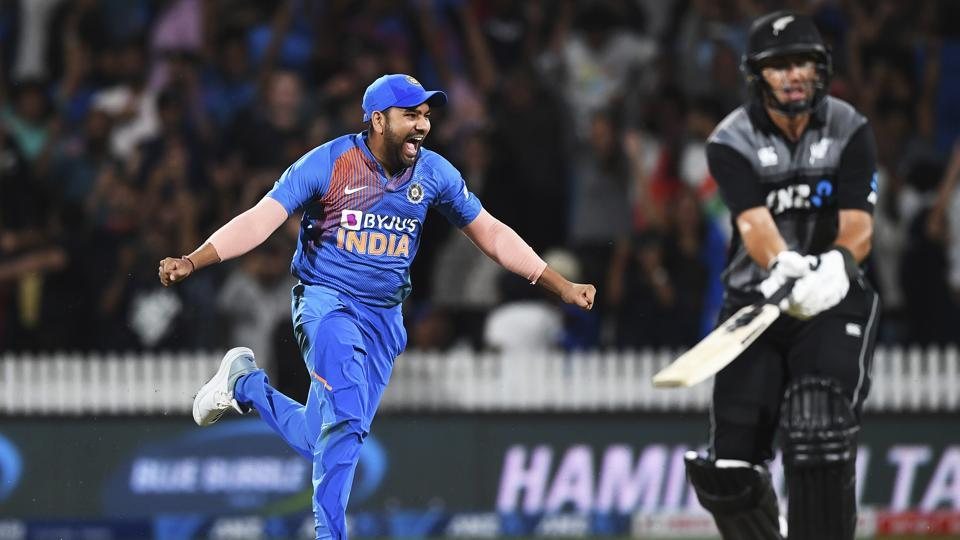 Rohit Sharma celebrates as New Zealand's Ross Taylor is bowled and the game is tied and goes to a super over