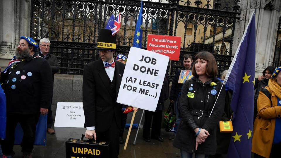 Anti-Brexit protesters demonstrate outside the Houses of Parliament in London.