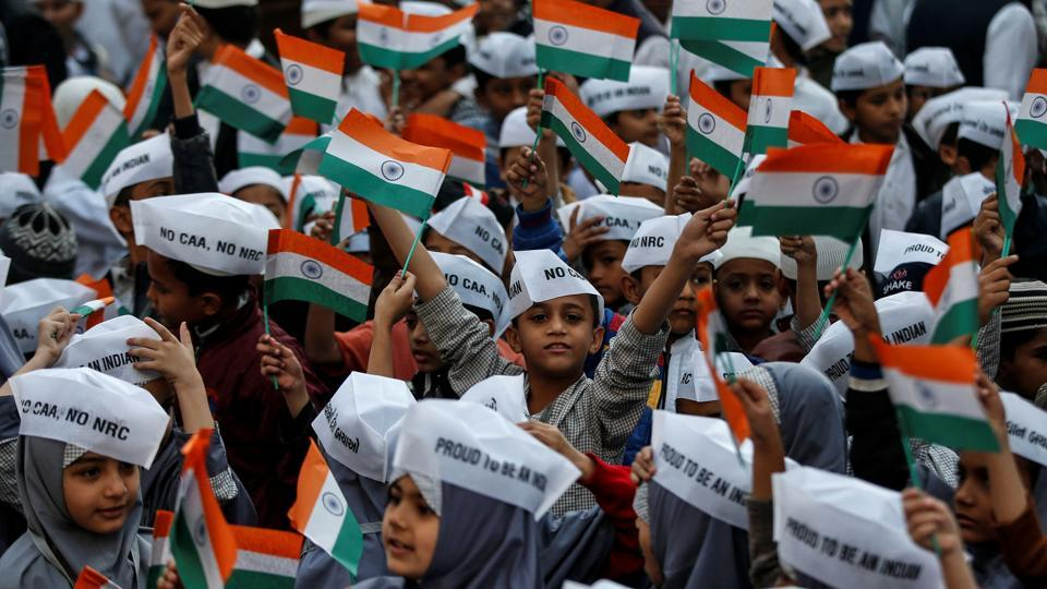 School children wearing caps attend Republic Day celebrations in Ahmedabad.