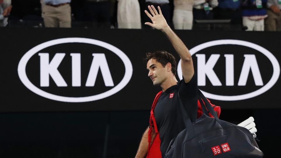 Switzerland's Roger Federer waves as he leaves the court after his match against Serbia's Novak Djokovic.