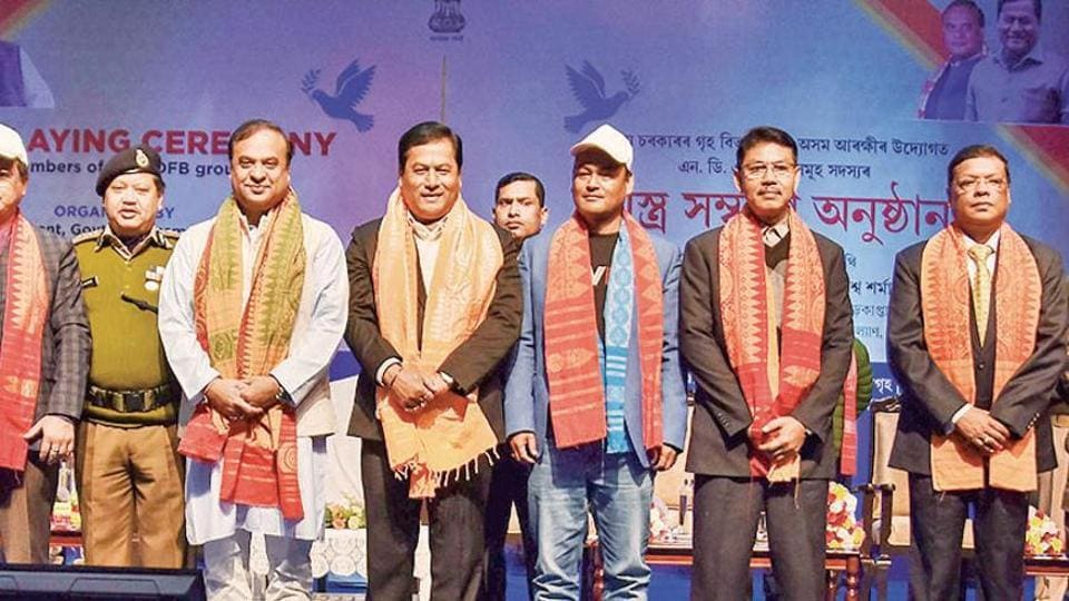 Assam chief minister Sarbananda Sonowal (fourth right) with NDFB chief Ranjan Daimary (second right) and others during an arms laying down ceremony in Guwahati on Thursday