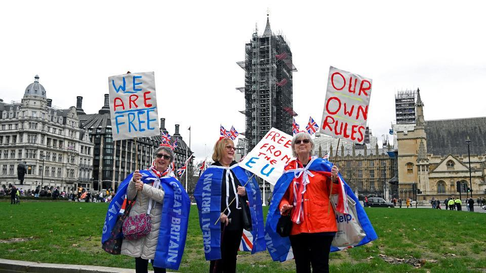 Pro-Brexit supporters pose at Parliament Square on Brexit day, in London.