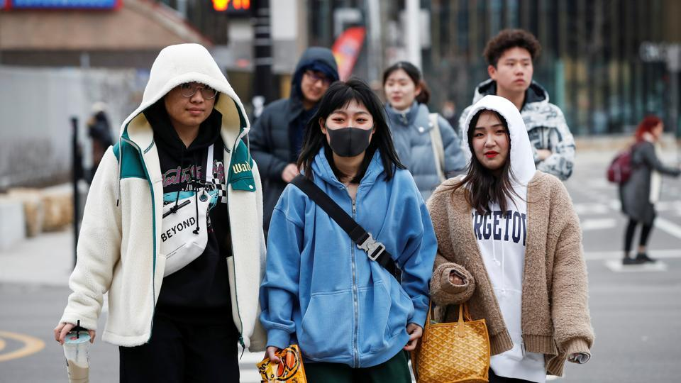 A woman wears a mask in Chinatown following the outbreak of the novel coronavirus, in Chicago, Illinois, US on January 30, 2020.