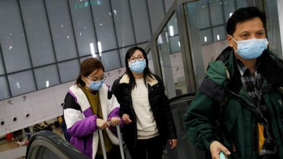 Passengers wear masks at Hong Kong West Kowloon High Speed Train Station Terminus, before temporary closing, following the coronavirus outbreak in Hong Kong, China, January 29, 2020.
