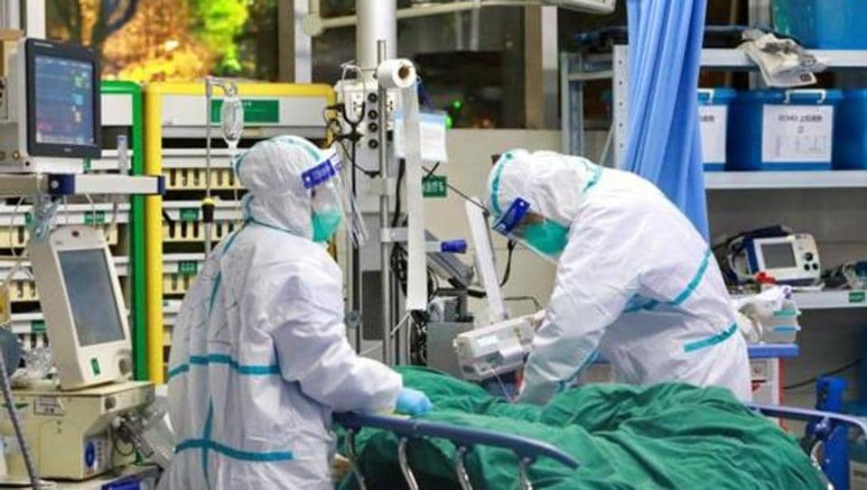 Medical staff in protective suits treat a patient with pneumonia caused by the new Coronavirus at the Zhongnan Hospital of Wuhan University in Wuhan, China.