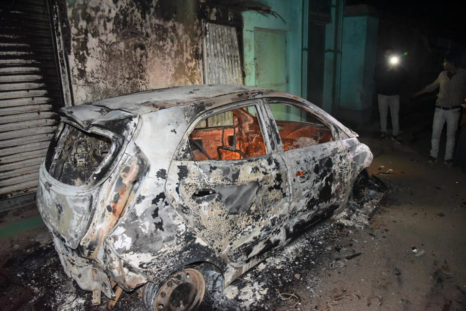 A charred vehicles after clashes between two groups during an immersion procession of goddess Saraswati at Ashok Raj Path, in Patna, Friday, Jan. 31, 2020.