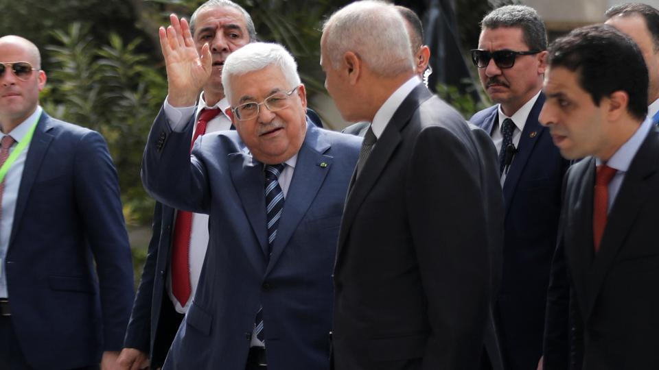 Palestinian President Mahmoud Abbas arrives for an emergency meeting with the Arab League's foreign ministers after U.S. President Donald Trump announced his Middle East peace plan, in Cairo.