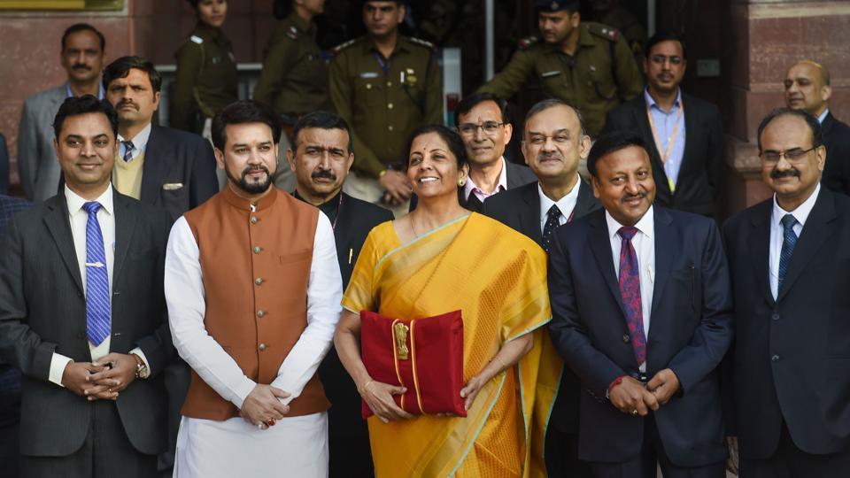 New Delhi: Union Finance Minister Nirmala Sitharaman, holding a folder containing the Union Budget documents, poses for photographers along with her deputy Anurag Thakur and a team of officials, outside the Ministry of Finance, North Block in New Delhi, Saturday, Feb. 1, 2020.