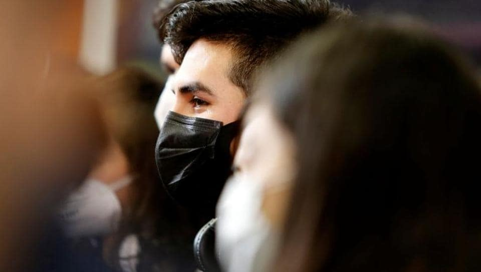 A student wears a protective mask upon his arrival at the Del Bajio International Airport, after the Guanajuato state government arranged the return from China for Mexican students due to the coronavirus outbreak.