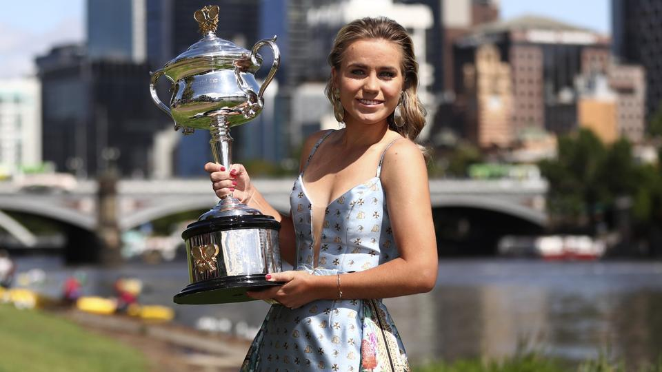 Sofia Kenin of the U.S. holds the Daphne Ackhurst Memorial Cup at a photo shoot.