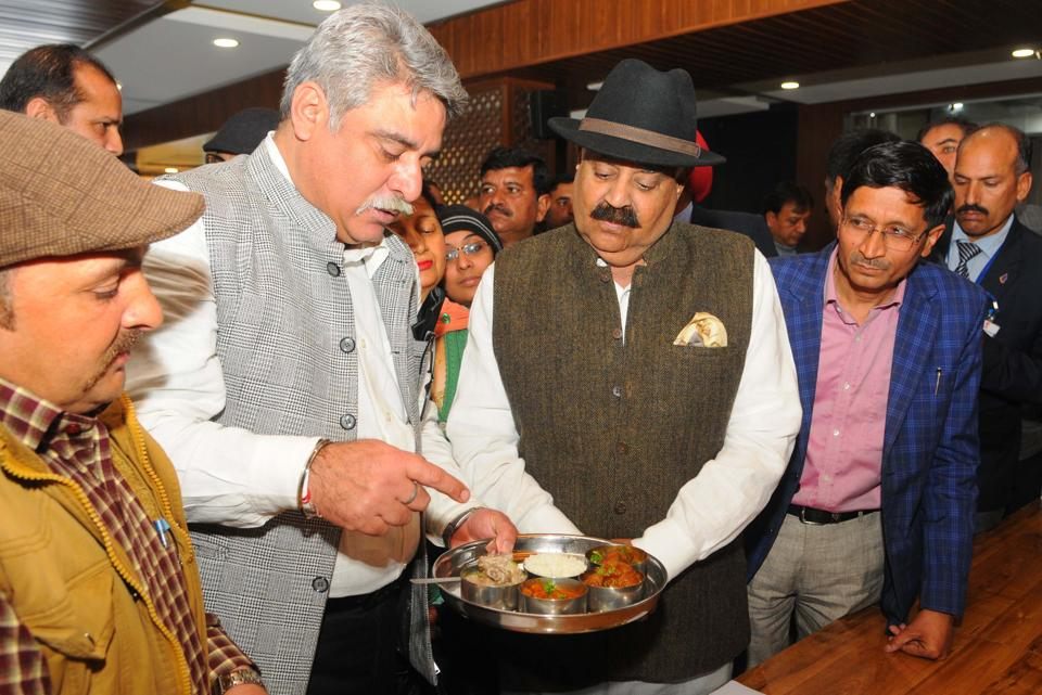 (From left) Chef Desraj and Kashmiri Sahayak Sabha secretary general Rajesh Pandita apprising Punjab governor and UT administrator VP Singh Badnore about the cuisine during the Kashmiri Food Festival organised at Chandigarh Press Club in Sector 27 on Sunday.