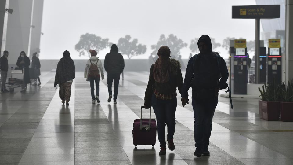 Fog brought down visibility around the Delhi airport Sunday morning.