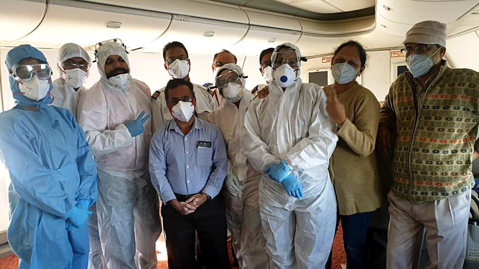 Medical officials prior to the screening of 323 Indians and 7 Maldives citizens, that took off from the coronavirus outbreak city Wuhan (China) in Air India special flight and landed at Delhi airport, on Sunday.