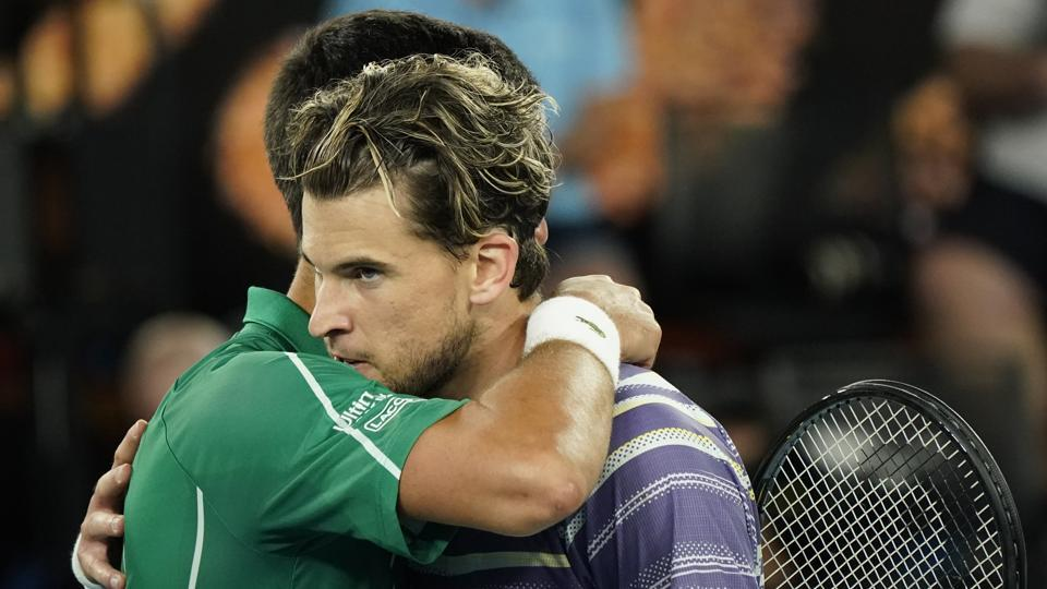 Serbia's Novak Djokovic embraces Austria's Dominic Thiem after winning the match.