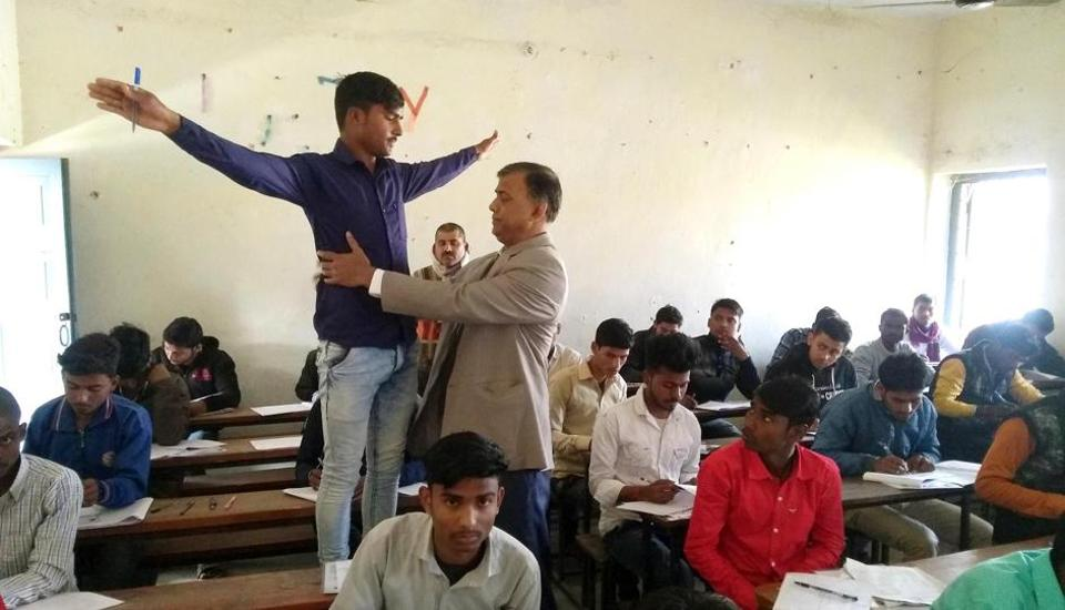 Chairman, Bihar School Examination Board, Anand Kishore is inspecting examinees at an examination centre during class 12th exams, conducted by Bihar School Examination Board in Patna. Bihar on Monday Feb 3, 2020.