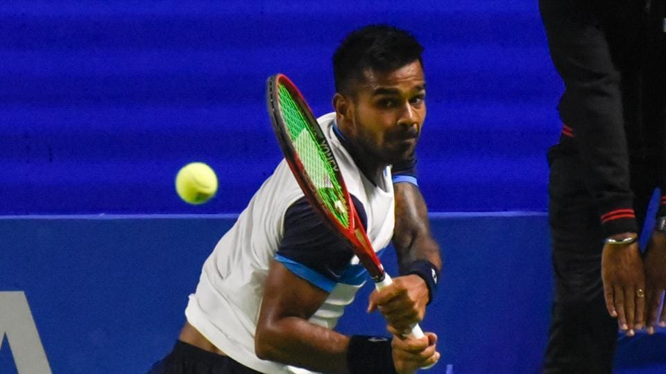 Sumit Nagal of India in action against V. Troicki of Serbia