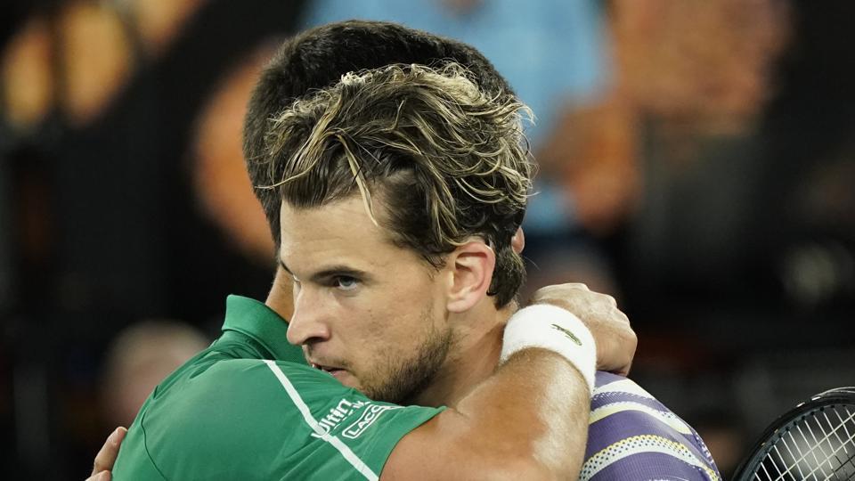 File image: Serbia's Novak Djokovic embraces Austria's Dominic Thiem after winning Australian Open final.