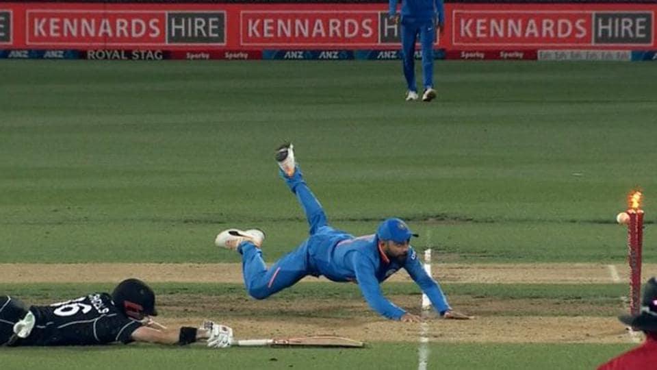 Virat Kohli runs out Henry Nicholls during India's first ODI against New Zealand in Hamilton.
