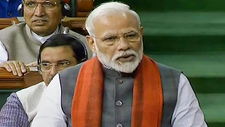 Prime Minister Narendra Modi rises to make a statement in the Lok Sabha, during the ongoing Budget Session of Parliament in New Delhi, Wednesday, Feb. 5, 2020.