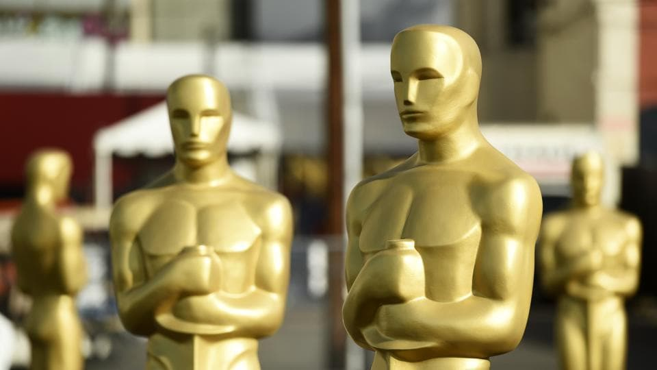 Oscar statues stand off of Hollywood Boulevard in preparation for Sunday's 92nd Academy Awards at the Dolby Theatre, Wednesday.